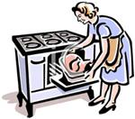 The woman is putting the food in the oven